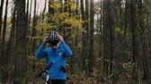рюкзак : Young bicycle rider outside in autumn nature.
