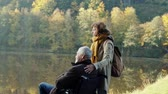 первый : Senior couple with wheelchair in autumn nature.