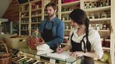 filozofie : A young man and woman shop assistant working in a zero-waste store or shop.