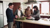 retirement home : Senior couple cooking dinner together with friends at home. Stock Footage