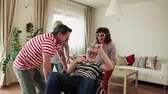 сумасшедший : Two senior couples with wheelchair having fun at the party at home.