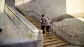 outdoor pursuit : Young couple runners running up the stairs in the city.