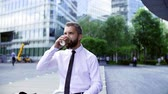 necktie : Hipster businessman sitting in the city, drinking coffee and checking the time.