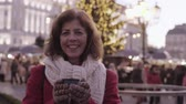tea time : Senior woman on an outdoor Christmas market. Stock Footage