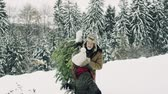 chop : Grandfather and small girl getting a Christmas tree in forest.