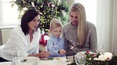 parıldıyor : A small boy with mother and grandmother holding sparkles at Christmas time.