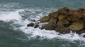 quebrado : Ocean waves beat on the rocks