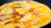тмин : Frying ham and eggs with cheese, sausages and pepper in pan sprinkled by Caraway seeds closeup.