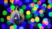 embellishment : New Year decorations ball on blinking multicolor circles bokeh background Stock Footage