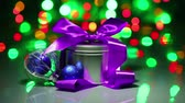 ribbon : Christmas decorations composition with fancy box on blinking bokeh background