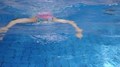 get in : Japanese girl swimming the breaststroke in the swimming pool