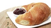 vajas : Rotating Croissant with Jam as endless loop video