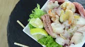 calamary : Portion of rotating Seafood Salad (not loopable full HD video)