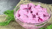 root vegetable dish : Portion of Herring Salad with beetroot (seamless loopable) as 4K UHD footage Stock Footage
