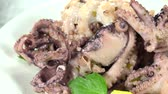 squid tentacles : Portion of rotating Octopus Salad (not loopable) as 4K UHD footage Stock Footage