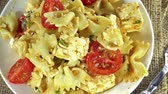 monitoring : Portion of Pasta Salad rotating as not loopable 4K UHD footage