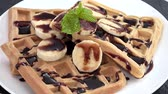 kaka : Rotating Waffles with Banana slices and Chocolate sauce not loopable, 4K Stockfilm