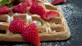 belga : Some homemade Waffles with fresh Strawberries not loopable, 4K footage