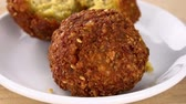 ervilha : Falafel on a rotating wooden plate (seamless loopable; 4K) Stock Footage