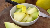 melão : Portion of fresh made Honeydew Melon on a wooden plate (not loopable; 4K)