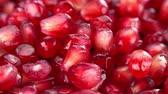 úsek : Pomegranate Seeds rotating on a wooden plate as seamless loopable 4K UHD footage