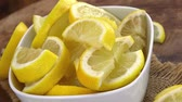 úsek : Sliced Lemons as not loopable roating 4K UHD footage