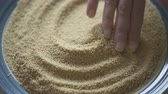 Slow Motion of  Dry Couscous Wheat Semolina. Close Up, Woman Hand Stock Footage