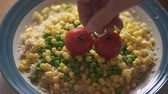 groszek : Cooked Couscous With Green Peas, Sweet Corn, and Red Tomatoes on a Plate. Slow Motion, Close Up Plate of Couscous with Some Vegetable Wideo