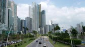 urbane : Panama CIty, Panama - march 2018: Road traffic on city highway (Avenida Balboa) in Panama CIty with modern skyline background. Stock Footage