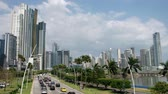 Panama CIty, Panama - march 2018: Road traffic on city highway (Avenida Balboa) in Panama CIty with modern skyline background. Stock Footage