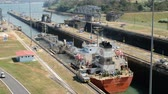 panama city : Panama City, Panama - march 2018: Ship crossing the Panama Canal at Miraflores Locks, Panama City Stock Footage