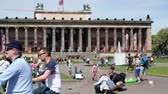Many people walking in Berlin during summer at the Lustgarten Park, in front of the Old Museum, next to Berlin Cathedral Stock Footage
