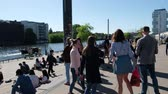 Young people at the Berlin Wall, East Side Gallery on a sunny summer day Stock Footage