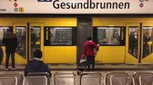 wagons : Metro  subway train arriving at train station (Gesundbrunnen) in Berlin Stock Footage