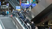 수하물 : traveling people with luggage on escalator inside crowded train station in Berlin, Germany