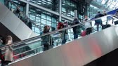 수하물 : People on escalator inside train station in Berlin, Germany