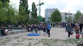 수하물 : Tourist couple walking through crowded public park (Mauerpark) passing street 무비클립