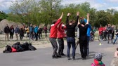 executante : Group of male breakdancers dancing ballet on street at crowded park (Mauerpark