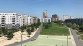 Berlin city skyline from elevated railroad bridge at park on sunny summer day