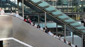 b roll : People on escalator, going to work in business district in Hong Kong, Centra