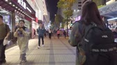 Time lapse of people on crowded street in shopping district of Hong Kong,