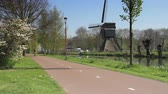 Bicyclists with windmill in The Netherlands