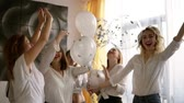 паз : Beautiful six women on a hen party are hanging out together. Dancing and having fun with baloons. All in identical clothes,jeans and white blouses. Indoors. Happy, carefree