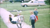 brother : Two little boys running and playing outside on the sidewalk during the summer of 1967.