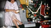 pijama : A mother gets a new nightgown and slippers on Christmas Day in 1956.