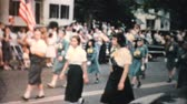 сбор винограда : Several teenage marching bands pass by in the annual town parade in the fall of 1959.