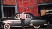 coletor : A proud young man shows off his beautiful new car in front of a hotel in 1964. Vídeos
