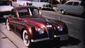city : A beautiful red Rolls Royce parked on the street and a Honeymoon getaway car near Ocean City, New Jersey in 1958.