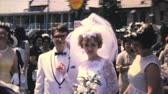 groomsmen : A happy newly married bride and groom leave the church and head to their wedding reception in 1966.