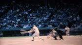 удара : A batter hits the ball at a major league baseball game in New York in the summer of 1967. Стоковые видеозаписи